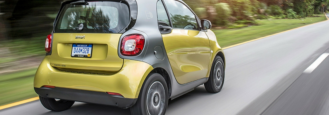 2018 smart fortwo yellow driving in the country