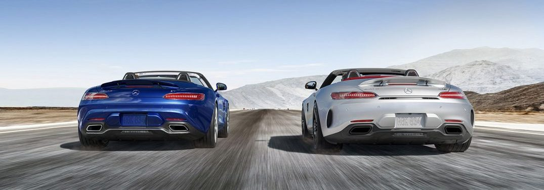 two 2018 AMG GT Roadsters driving side by side