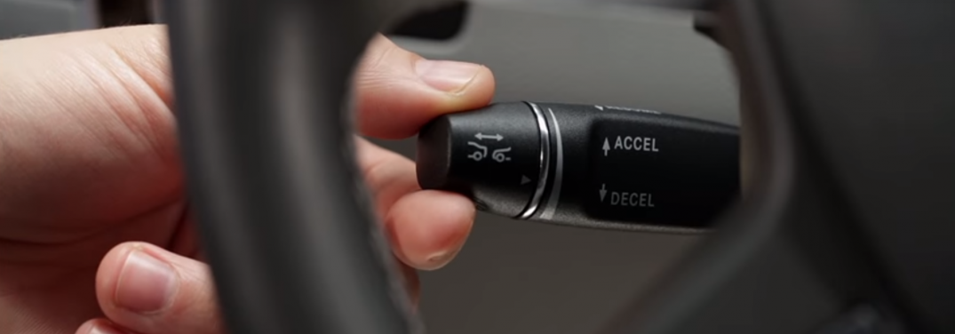 hand using the DISTRONIC PLUS System in a Mercedes-Benz vehicle