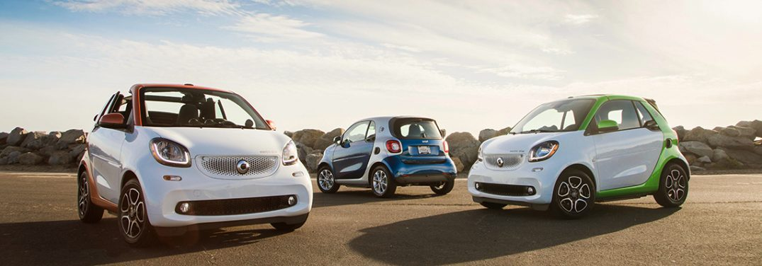 three smart fortwo electric drive vehicles parked near each other