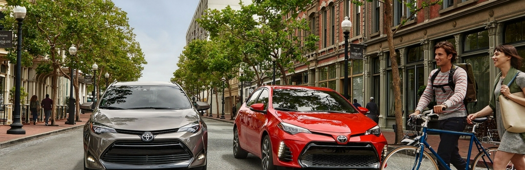 2018 Toyota Corolla parked outside with people walking.
