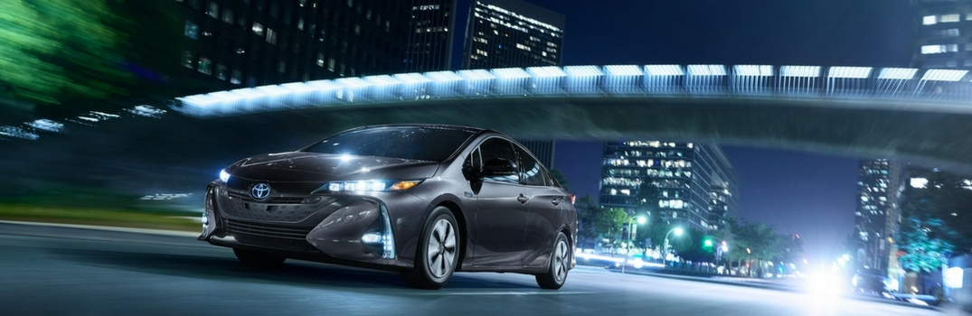 2018 Toyota Prius Prime driving down the road.