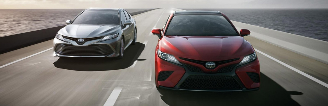 2019 Toyota Camry driving down the road