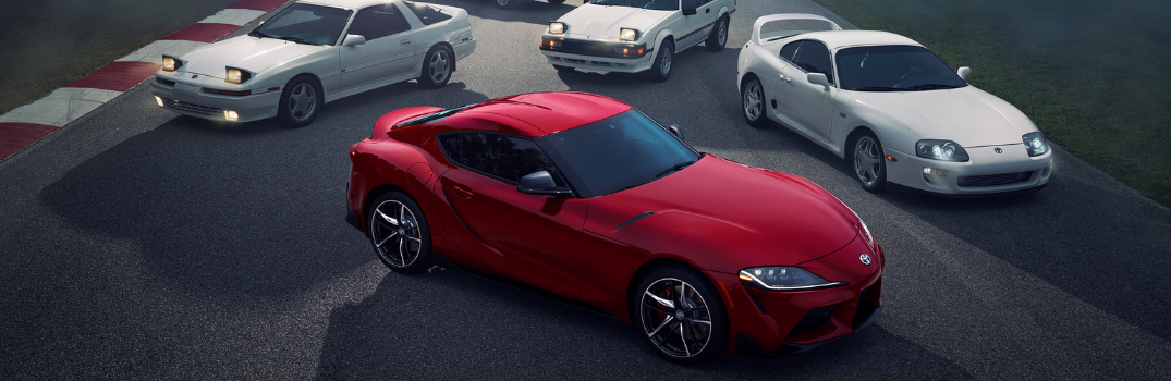 2020 Toyota Supra parked with its predecessors
