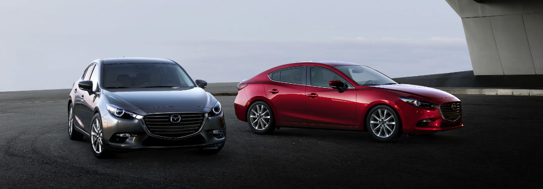 Two 2018 Mazda3 models, front side exterior of both