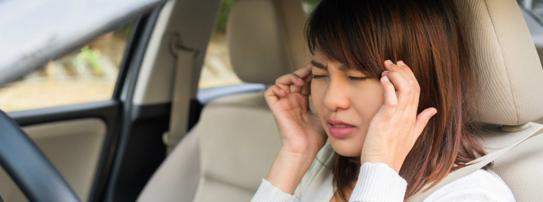 Woman with a Headache in Car
