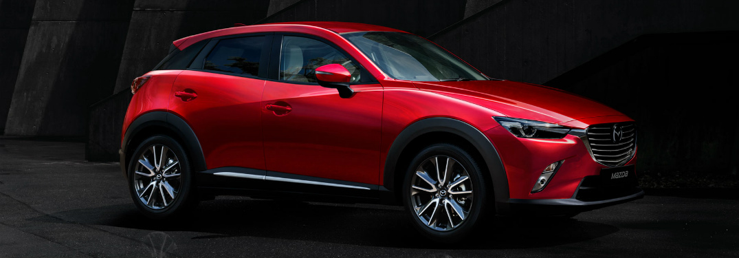 2018 Mazda CX-3 side view in Soul Red