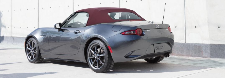 2018 Mazda MX-5 Miata gray with a Dark Cherry soft top back view