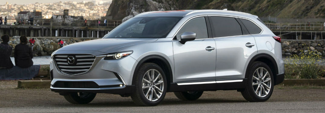 Driver side exterior view of a gray 2018 Mazda CX-9