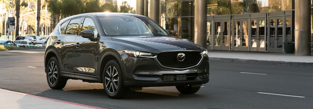 Front exterior view of a gray 2018 Mazda CX-5
