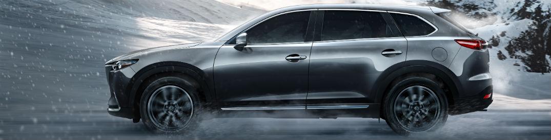 Driver side view of a gray 2018 Mazda CX-9
