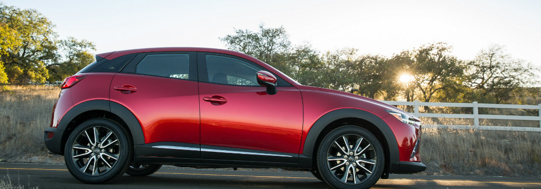 2018 Mazda CX-3 in red on a country road at sunset