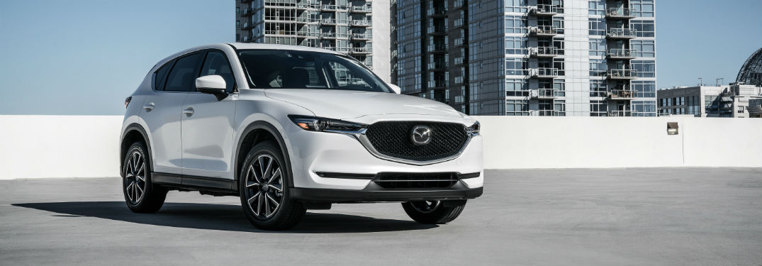 Front exterior view of a white 2018 Mazda CX-5