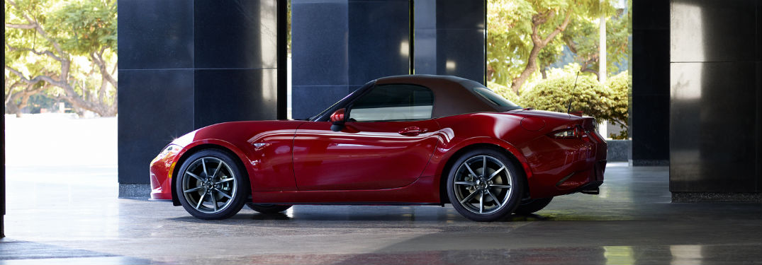 Driver side exterior view of a red 2019 Mazda MX-5 Miata