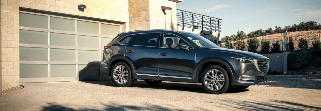 Passenger side exterior view of a black 2018 Mazda CX-9