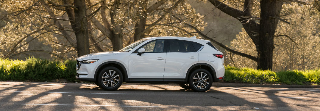 Driver side exterior view of a white 2018 Mazda CX-5