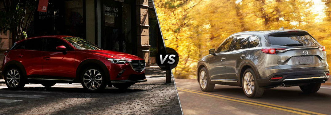 "Passenger side exterior view of a red 2019 Mazda CX-3 on the left ""vs"" rear driver side exterior view of a gray 2019 Mazda CX-9 on the right"