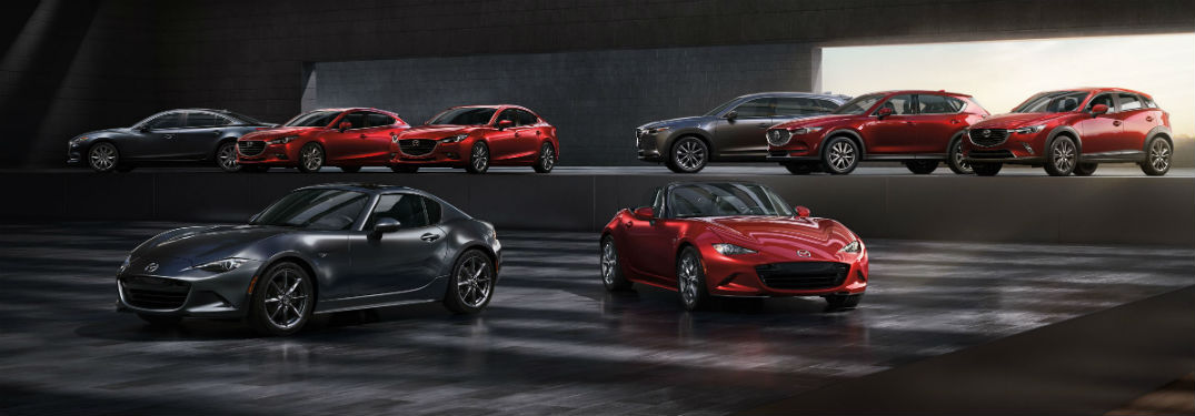 2019 Mazda vehicle lineup parked next to each other on two levels of stages