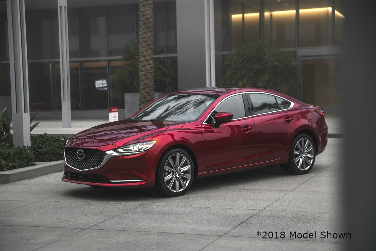 Driver side exterior view of a red 2018 Mazda6