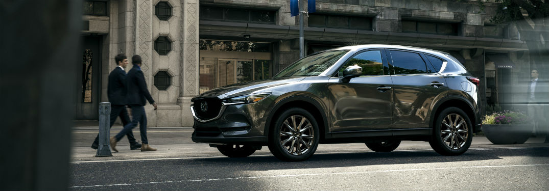 Driver side exterior view of a gray 2019 Mazda CX-5