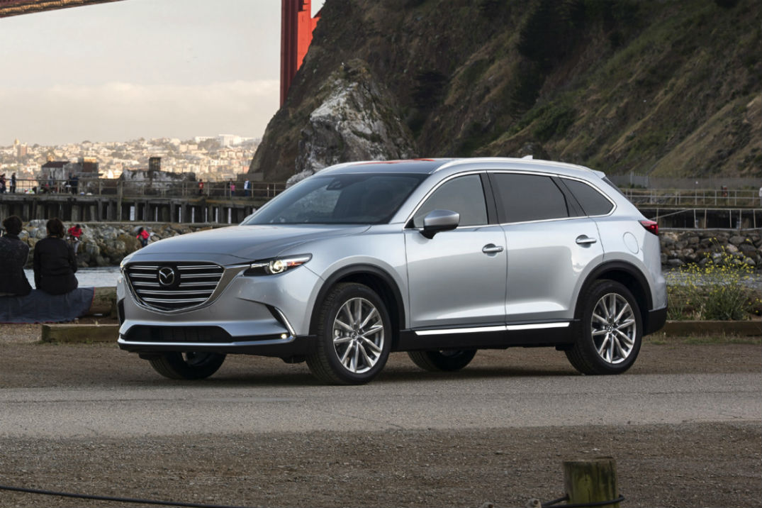 Front driver side exterior view of a gray 2018 Mazda CX-9