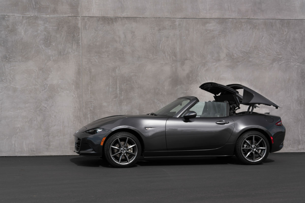 Driver side exterior view of a gray 2018 Mazda MX-5 Miata RF removing its roof