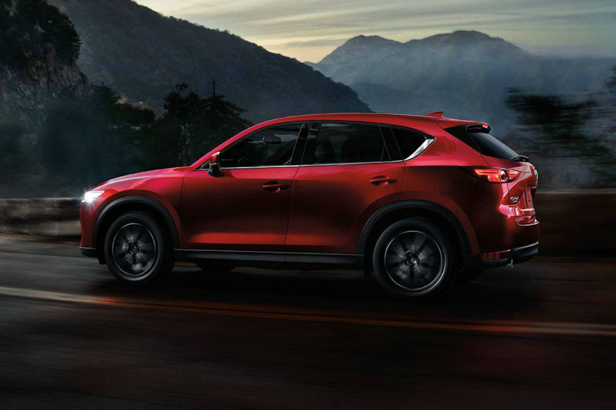 Driver side exterior view of a red 2018 Mazda CX-5