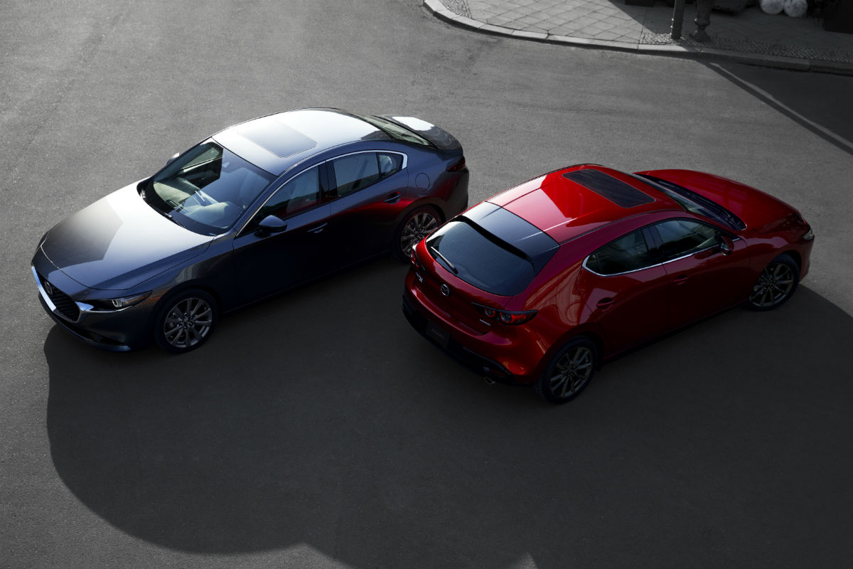 Overhead view of a gray 2019 Mazda3 4-door parked nest to a red 2019 Mazda3 5-door