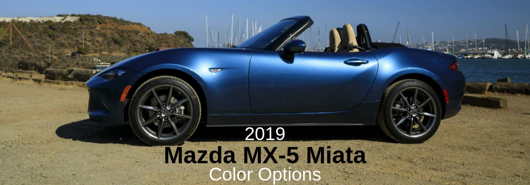 2019 Mazda MX-5 Miata Color Options, text on a driver side exterior image of a blue 2019 Mazda MX-5 Miata