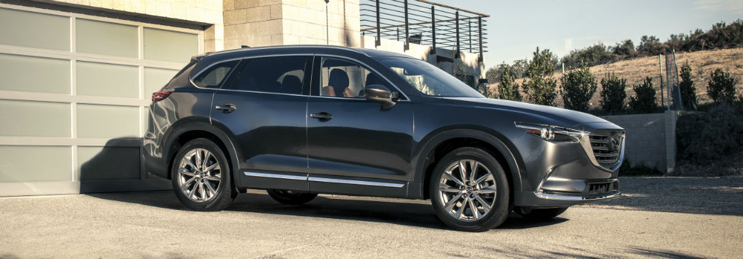 Passenger side exterior view of a gray 2019 Mazda CX-9