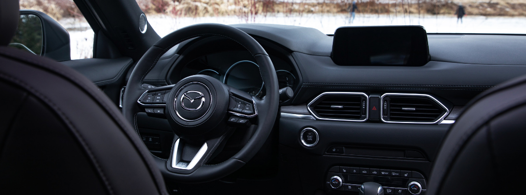 front interior of 2019 mazda cx-5 including steering wheel and infotainment system