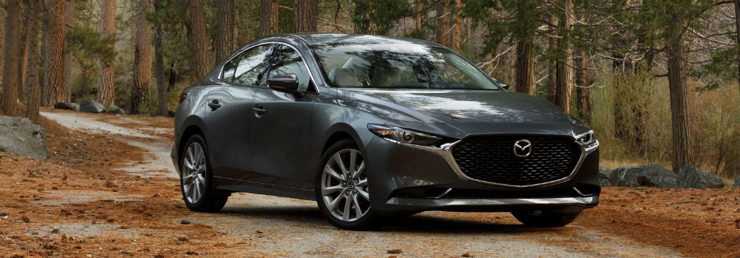 Front passenger side exterior view of a gray 2019 Mazda3
