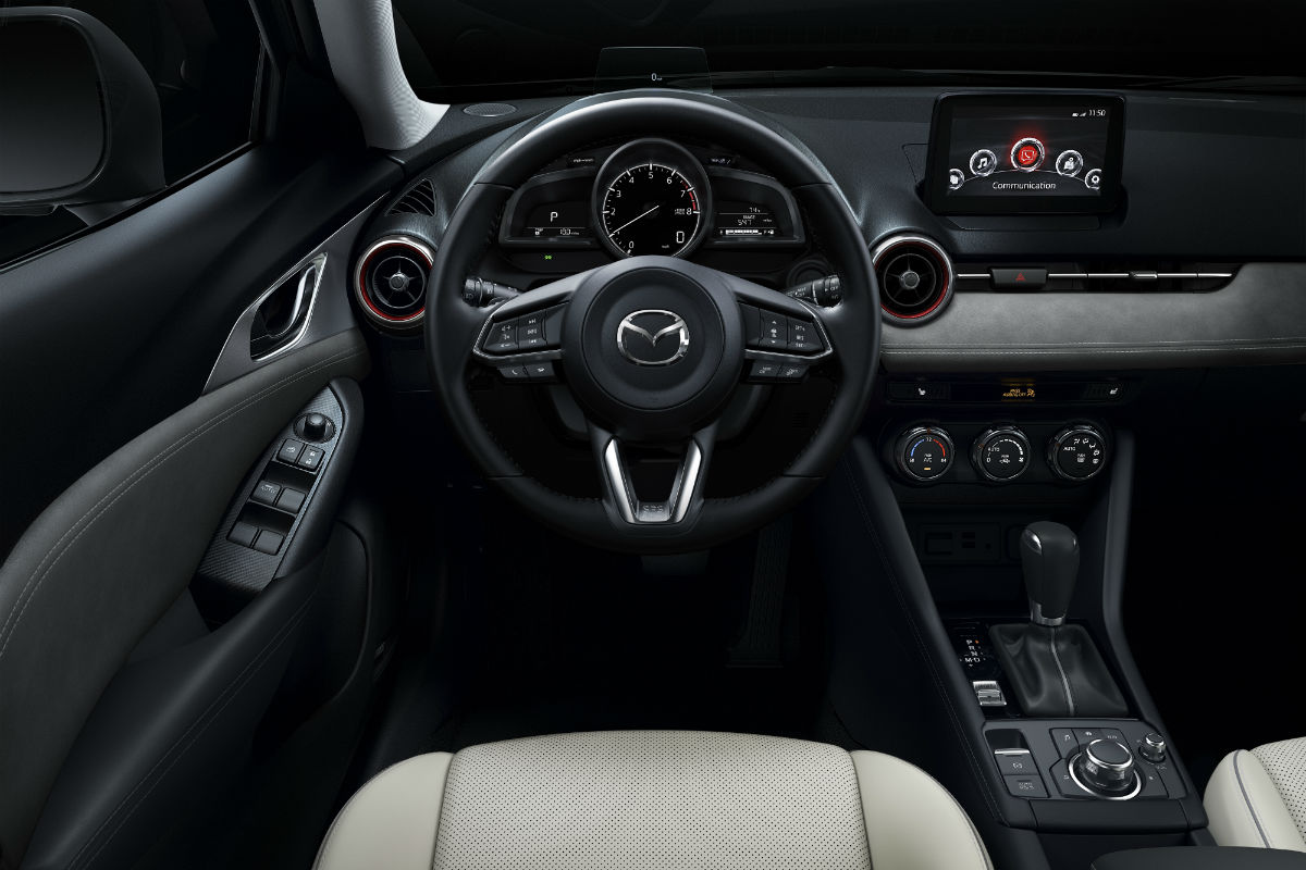Steering wheel mounted controls and driver information cluster of the 2019 Mazda CX-3