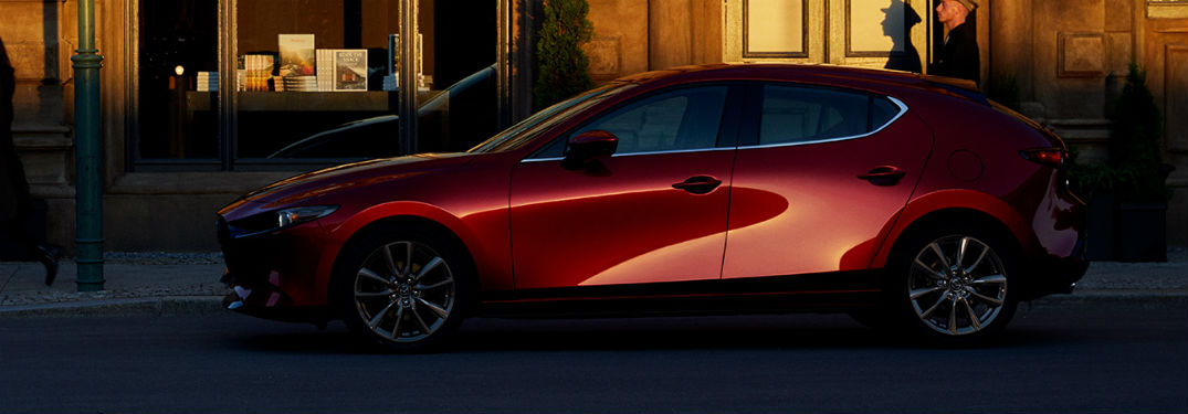 Driver side exterior view of a red 2019 Mazda3 Hatchback