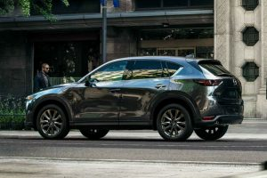 Driver side exterior view of a black 2019 Mazda CX-5