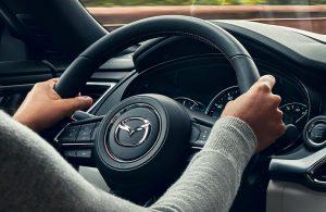 woman driving a Mazda vehicle
