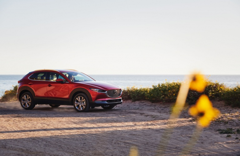 2021 Mazda CX-30 red side view at the beach