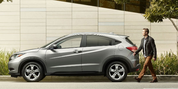Side View of the 2017 Honda HR-V in Silver With Man Standing by the Trunk Space