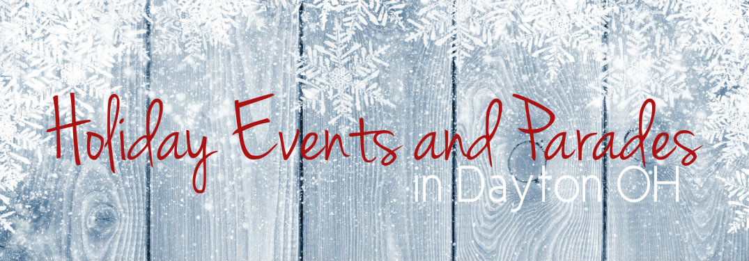 Text-saying-holiday-events-and-parades-in-dayton-with-snow-covered-wood-texture-background