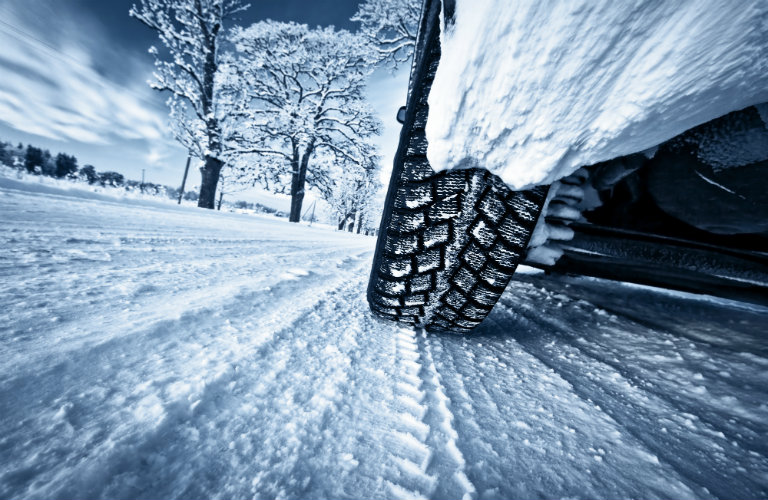 Close-up-of-car-tires-on-winter-road