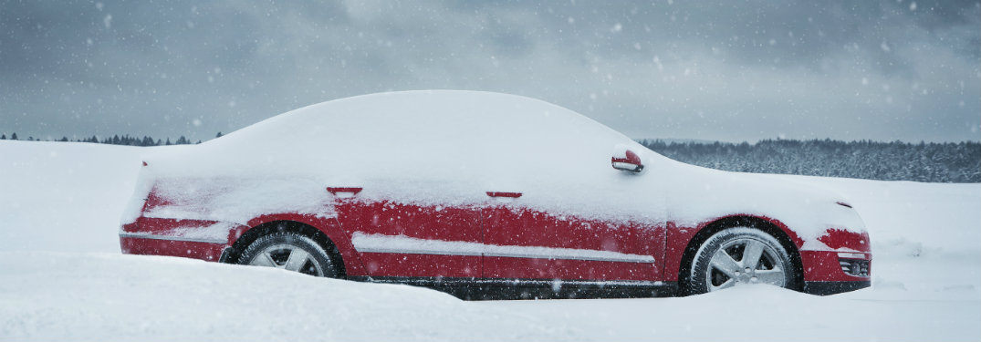 Red-car-stuck-in-snow