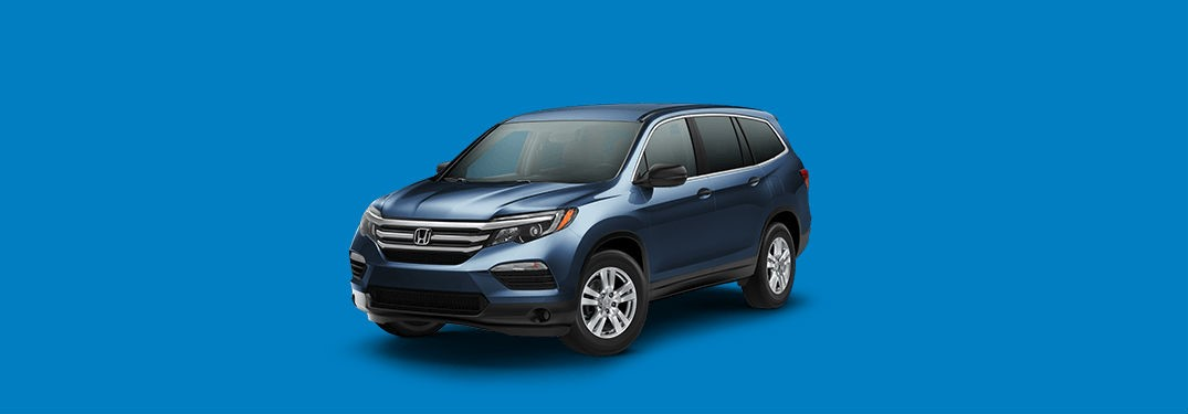 2018 Honda Pilot LX Exterior Front Fascia and drivers side with blue background