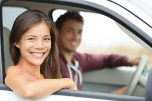 couple driving in new car