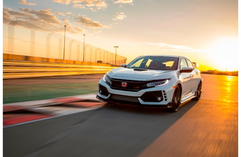 2017 and 2018 Honda Civic Type R exterior shot driving down a race track at sunset