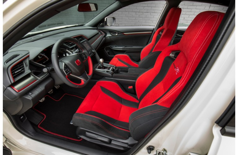 2018 Honda Civic Type R interior side shot of front seating upholstery and steering wheel