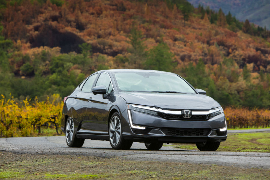 2018 Honda Clarity Plug-In Hybrid exterior front fascia passenger side road and tree covered hills
