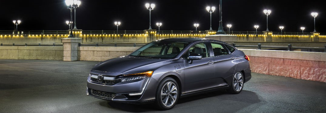 2018 Honda Clarity Plug-In exterior front fascia drivers side at night with street lamps in background