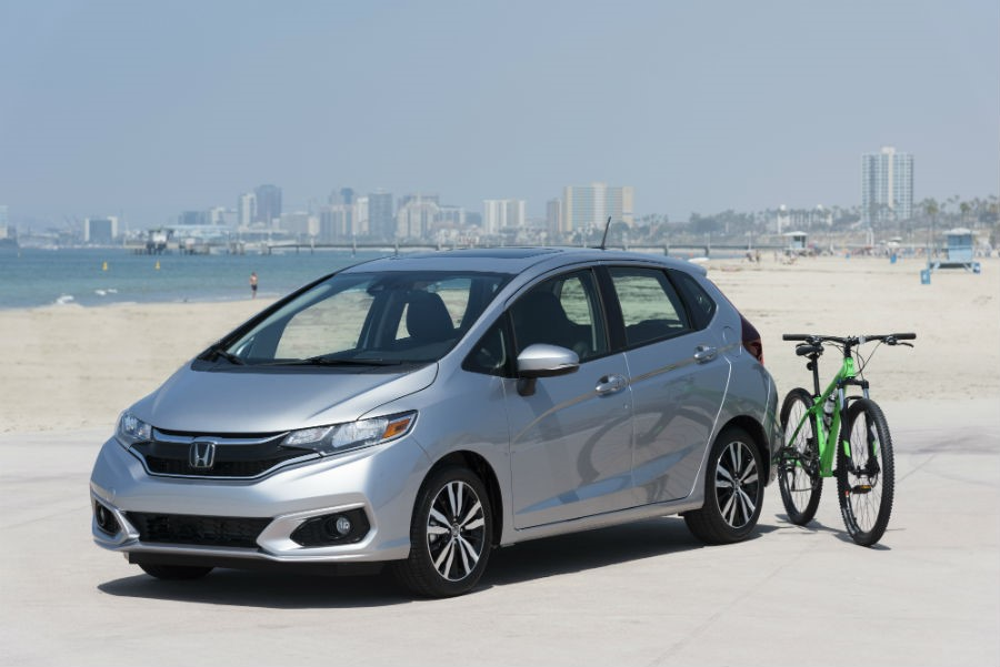 2018 Honda Fit exterior front fascia drivers side on beach with bike next to it