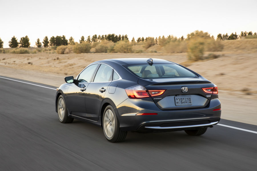 2019 Honda Insight exterior back fascia and drivers side going fast on road with dead grass