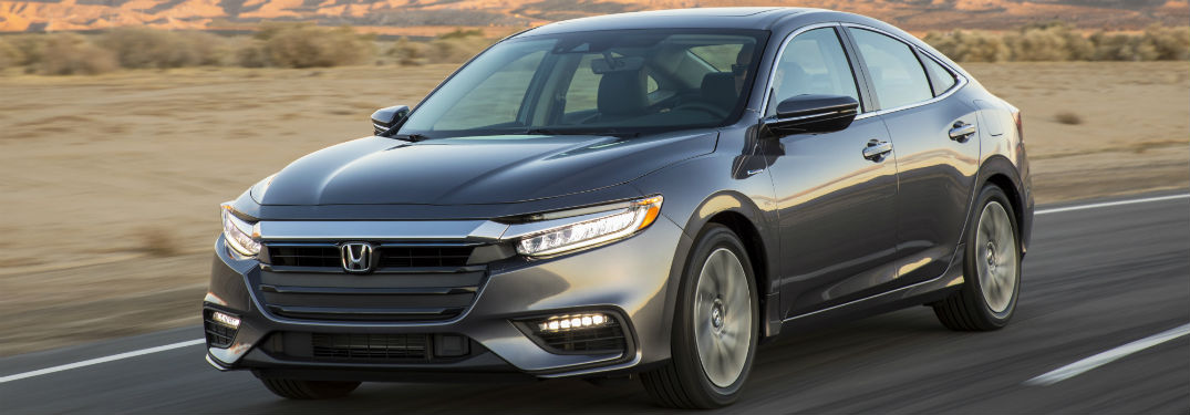 2019 Honda Insight exterior front fascia and drivers side going fast on desert road